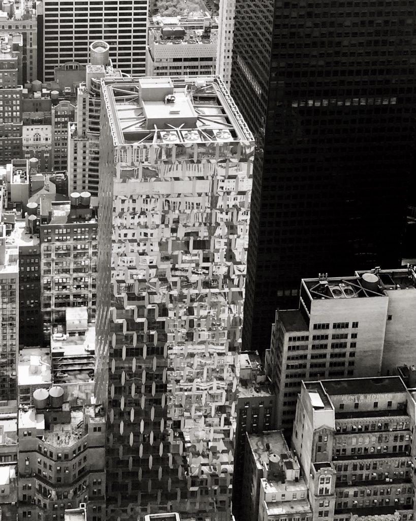Dense metallic skyscrapers seen from above in manhattan new york