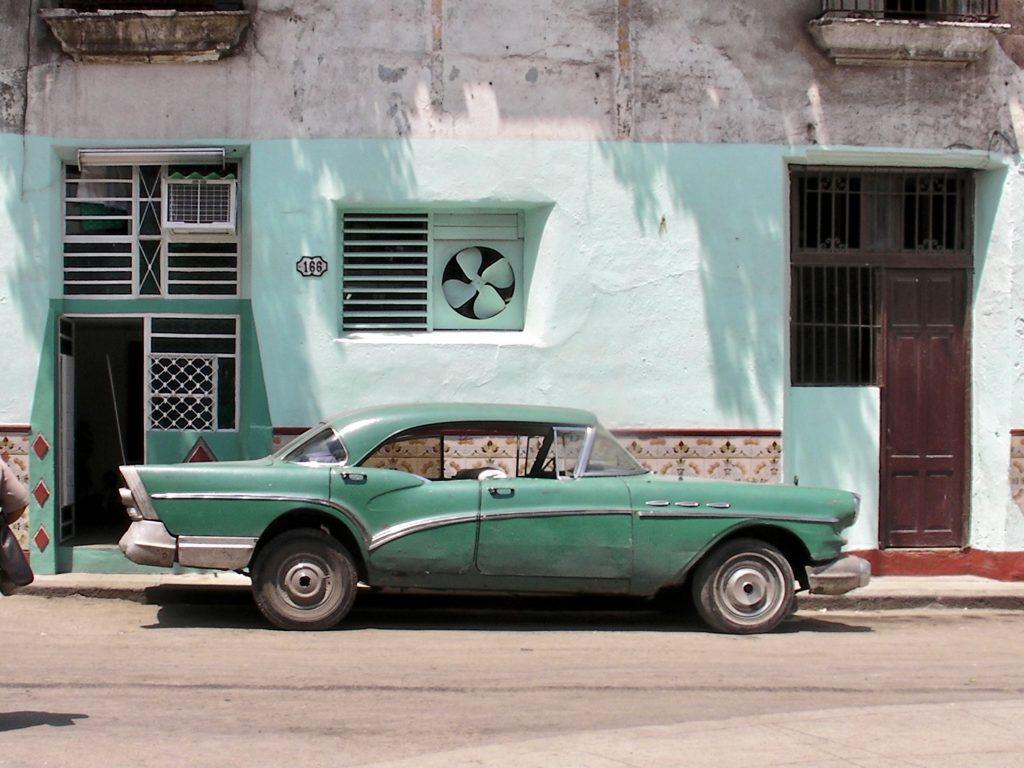 Green classic american car in the street in Havana Cuba