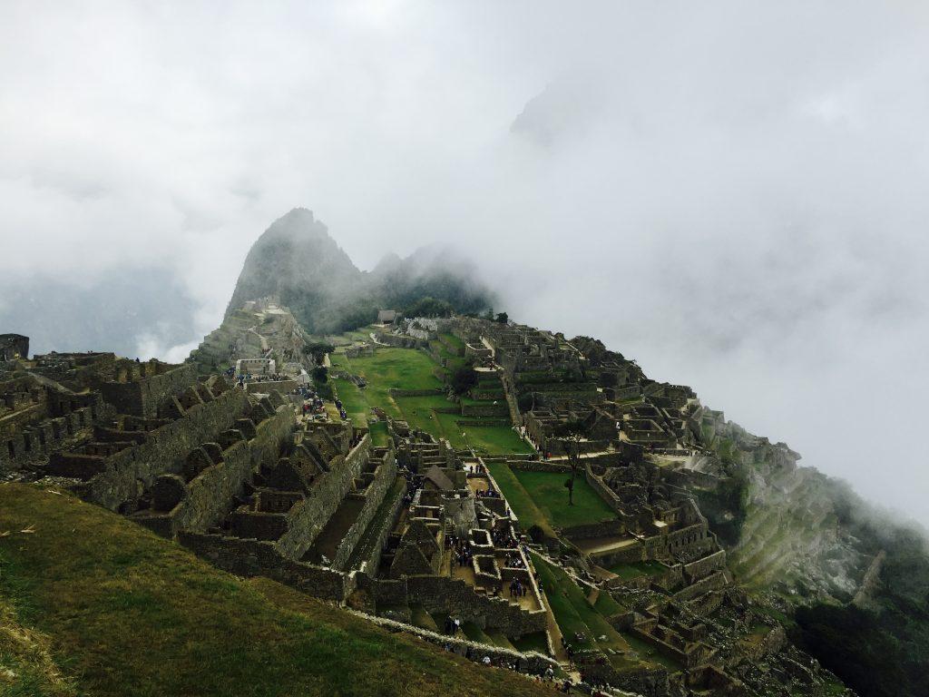 Inca citadel shrouded in clouds at machu picchu in peru