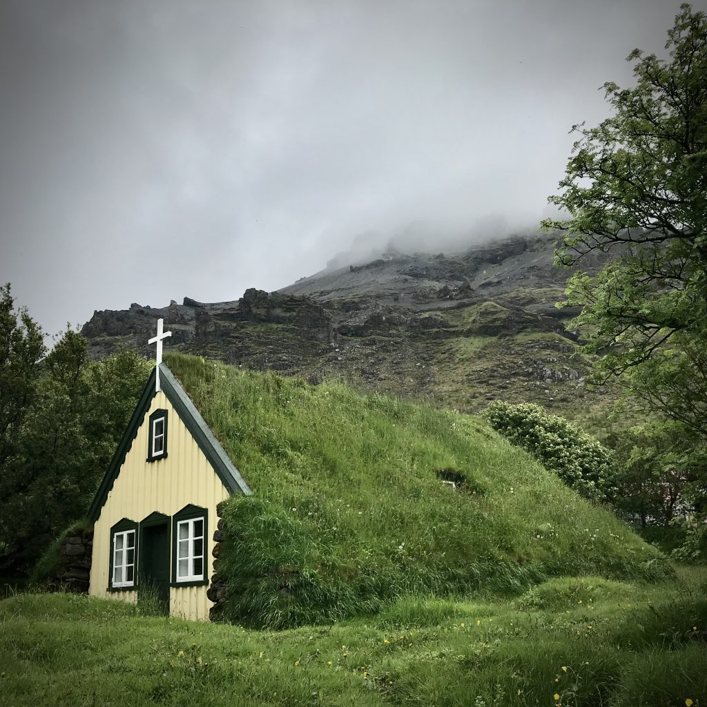 Green turf-covered church at Hof in Iceland