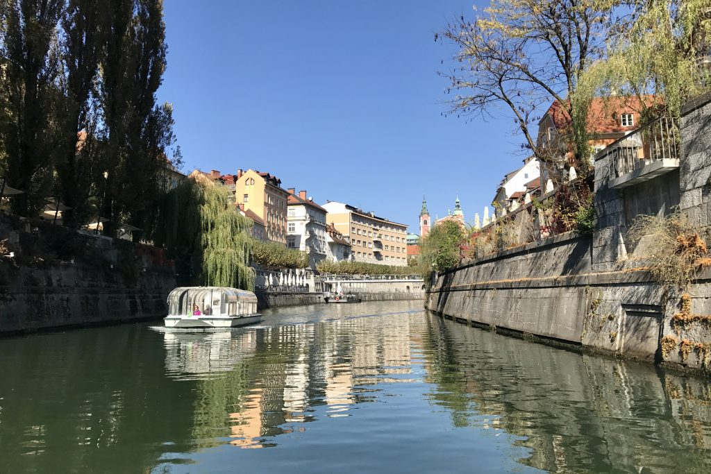 Ljubljanica River with riverside bars weeping willows and boats