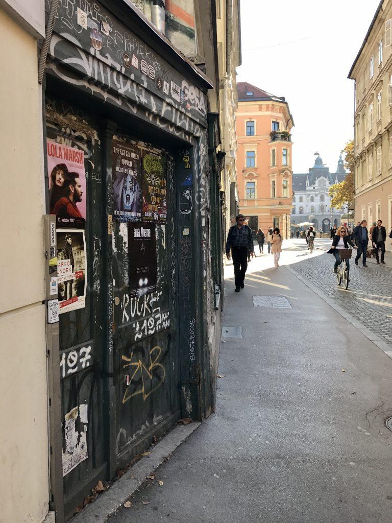 Ljubljana street with graffiti on doorway