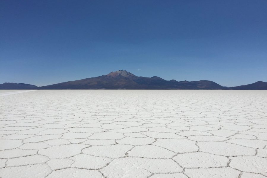white salt flats and black volcano at salar de uyuni in bolivia