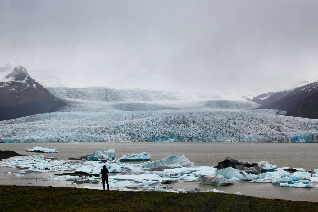 Author alone at the shore of Fjallsarlon glacial lagoon in Iceland