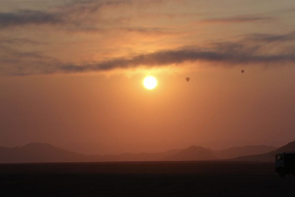 Hot air balloons in the early morning light at sossusvlei in the namib desert