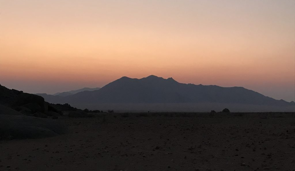 Dusky sky over the Mountains and plains in the NamibRand Nature Reserve in Namibia