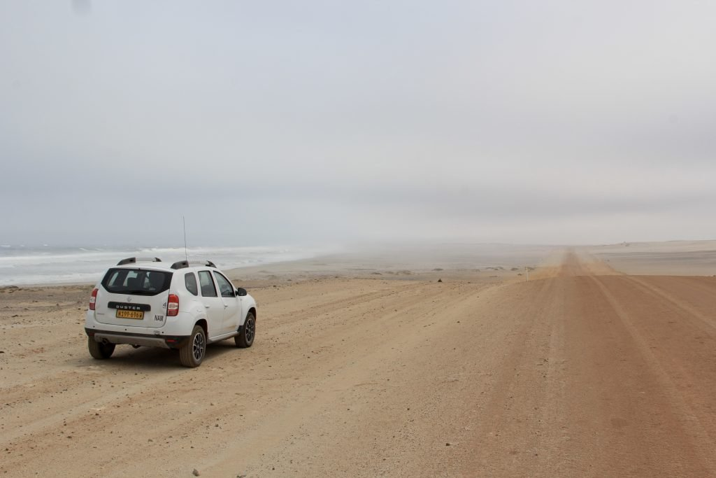car on the side of the desrted C34 road along the skeleton coast in namibia