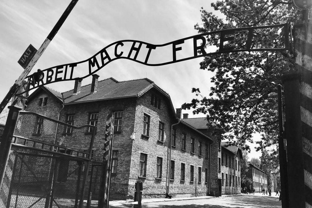 Gates to Auschwitz extermination camp bearing the words Arbeit Macht Frei