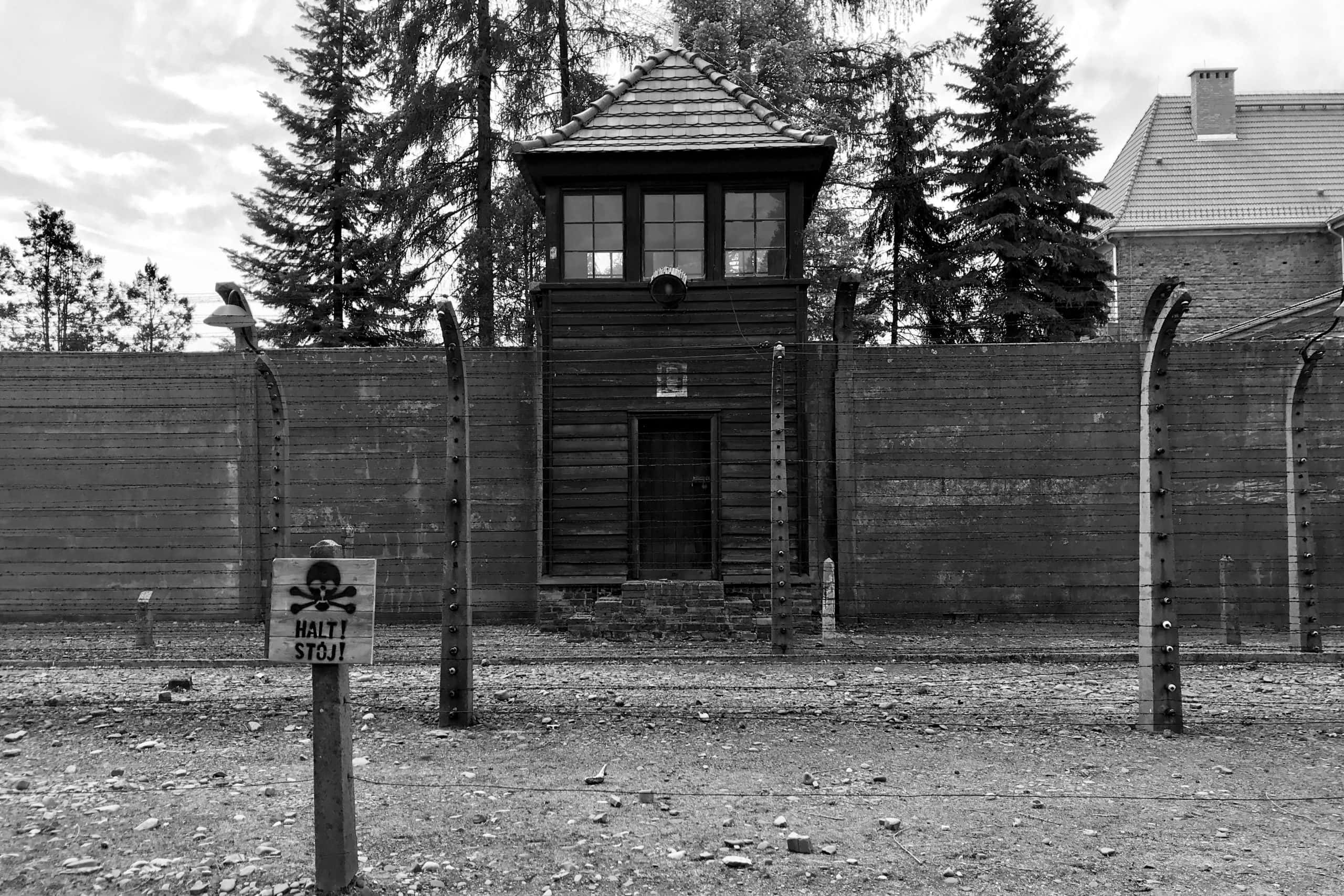 Guard Tower at the fence of Auschwitz ! with a sign saying Halt! Stoj!