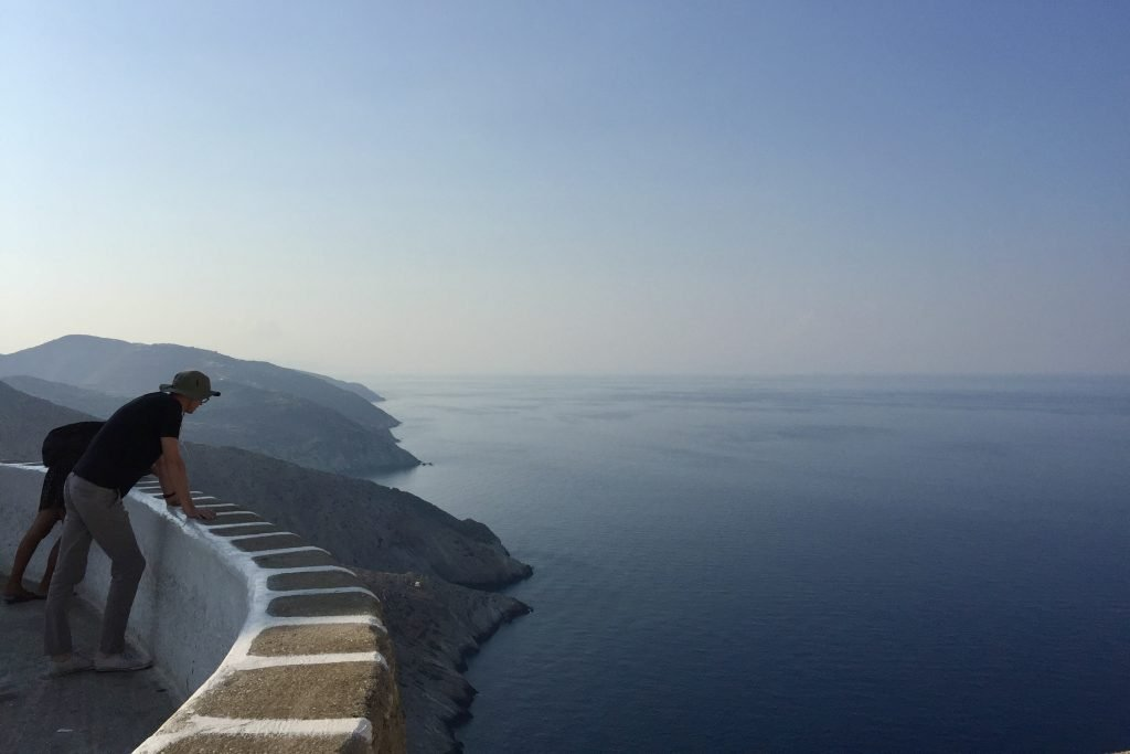 Viewpoint on Folegandros overlooking cliffs and the blue aegean sea