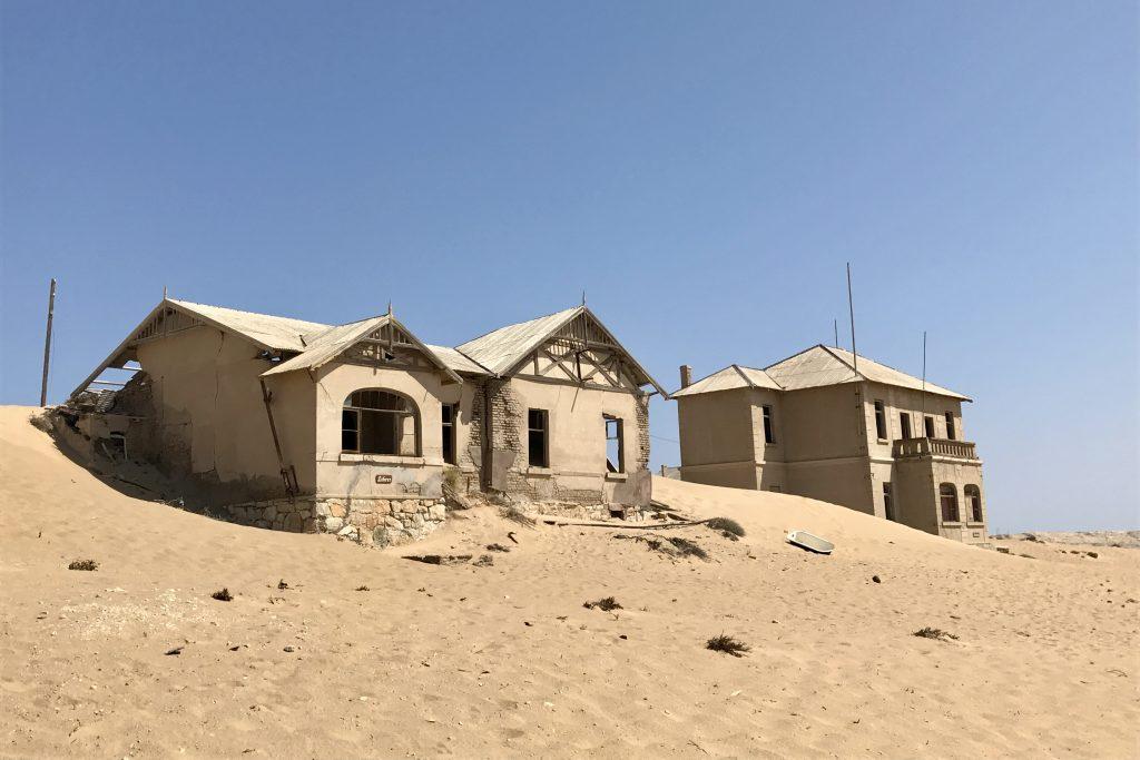 houses being reclaimed by the desert at the ghost town of kolmanskop in the namib desert