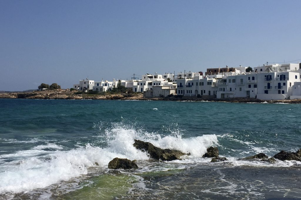 Row of white houses on the shore of Naousa Town on the island of Paros