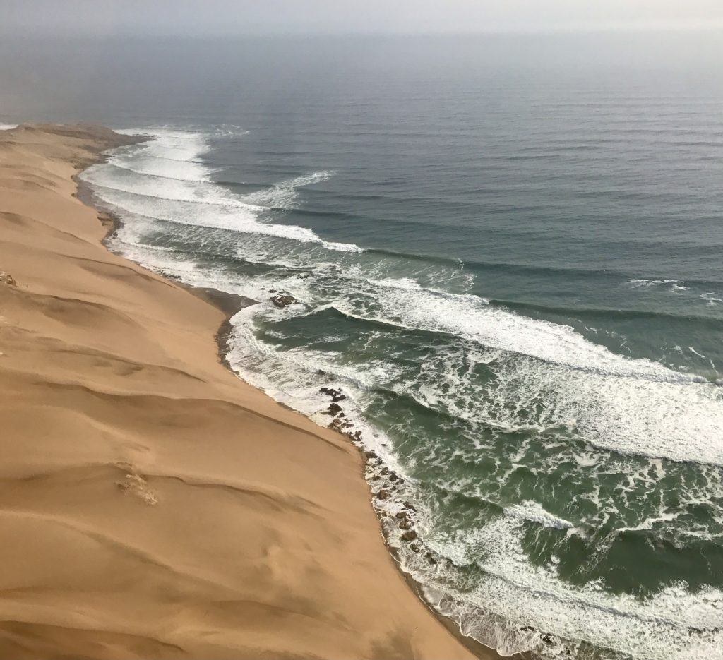 Fluid yellow dunes at the coast of the namib desert in namibia seen from the air