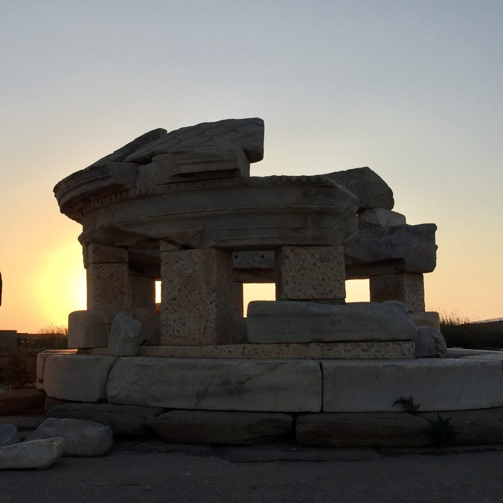 Sunset behind the ancient remains on the island of Delos