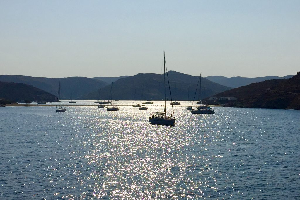 Yachts in the bay near Kolona beach on Kythnos island in the late afternoon
