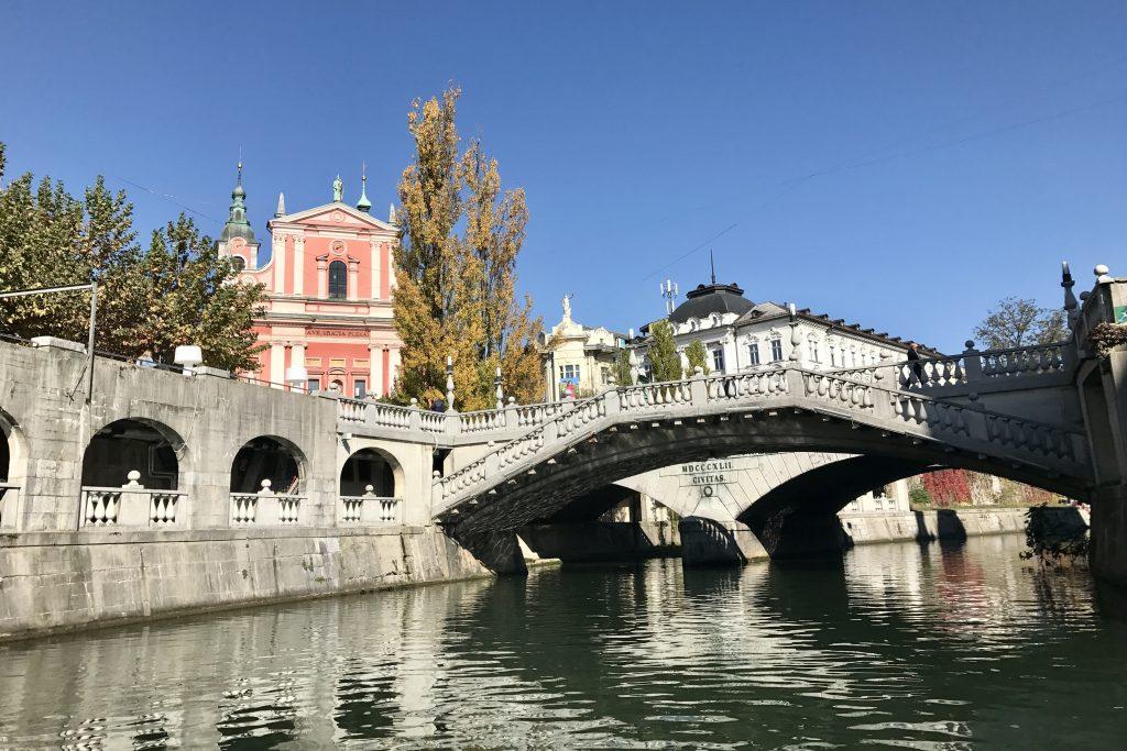 View of the pink church and triple bridge in Ljubljana in Slovenia