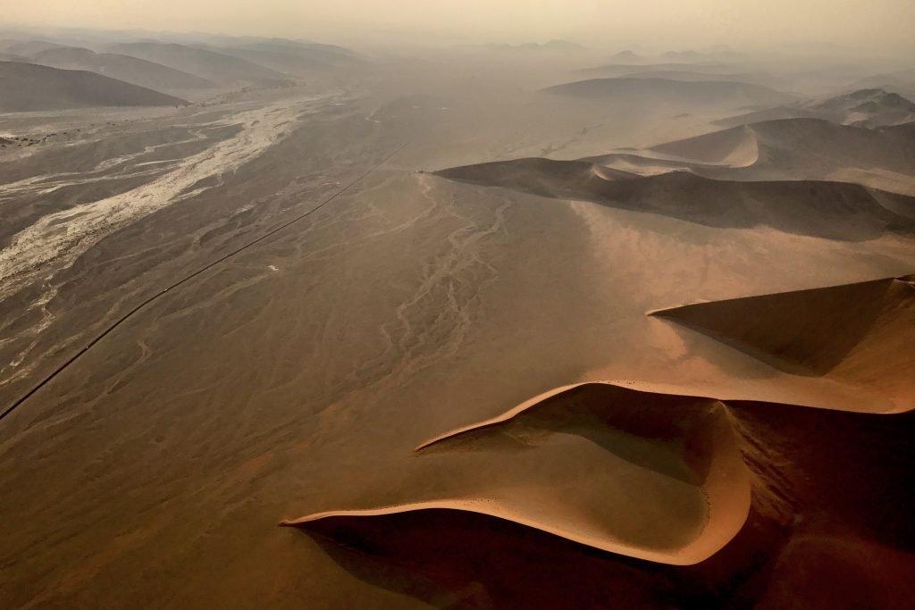 Sunrise along the Tsauchab Corridor during a scenic flight over Namibia