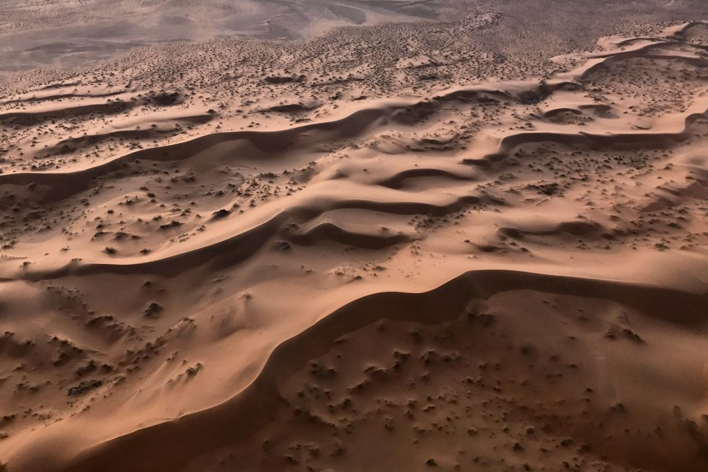 smooth mauve coloured sand dunes in the namib desert
