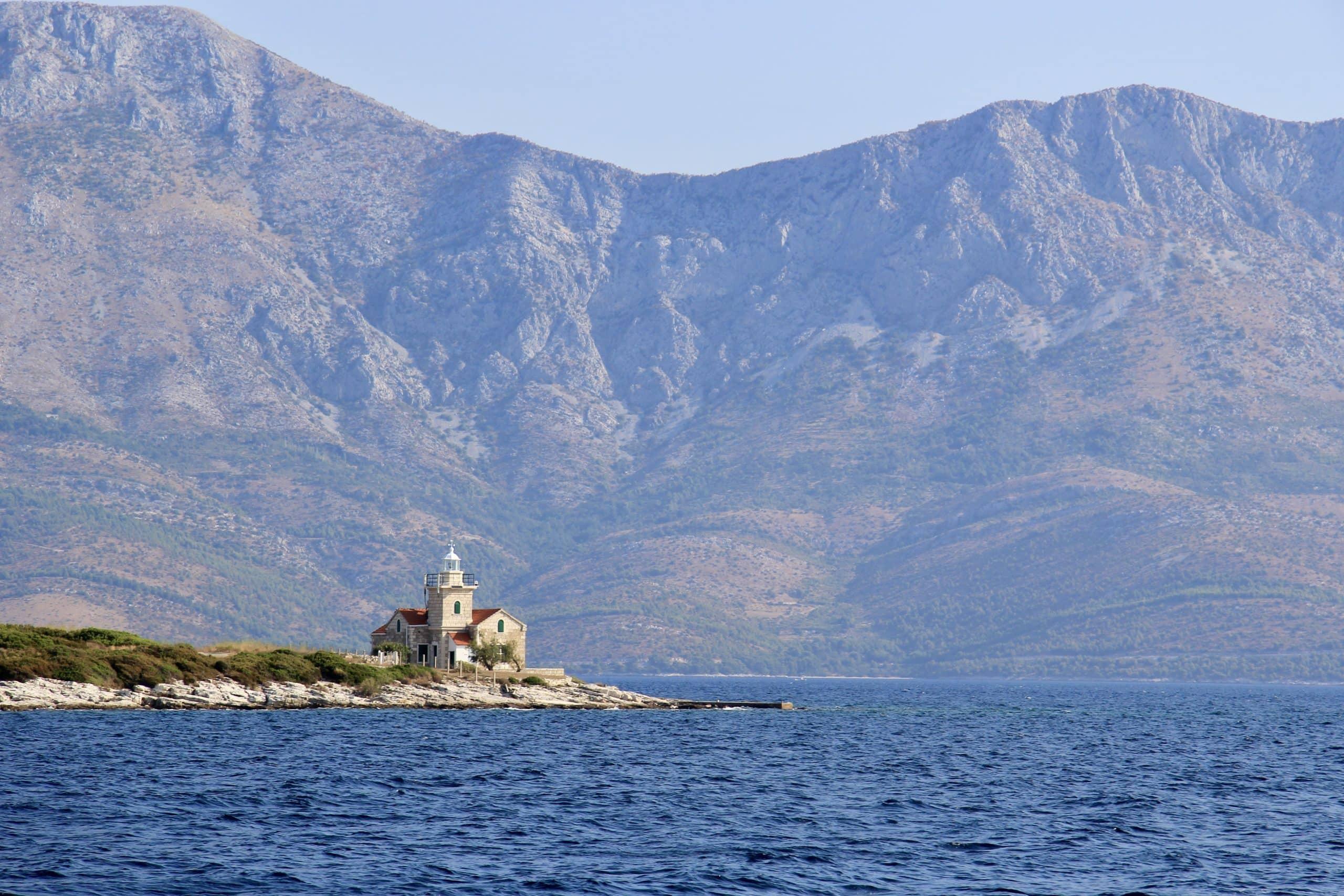 Sućuraj lighthouse on Hvar Island seen whilst sailing in t he Dalmatian Coast of Croatia