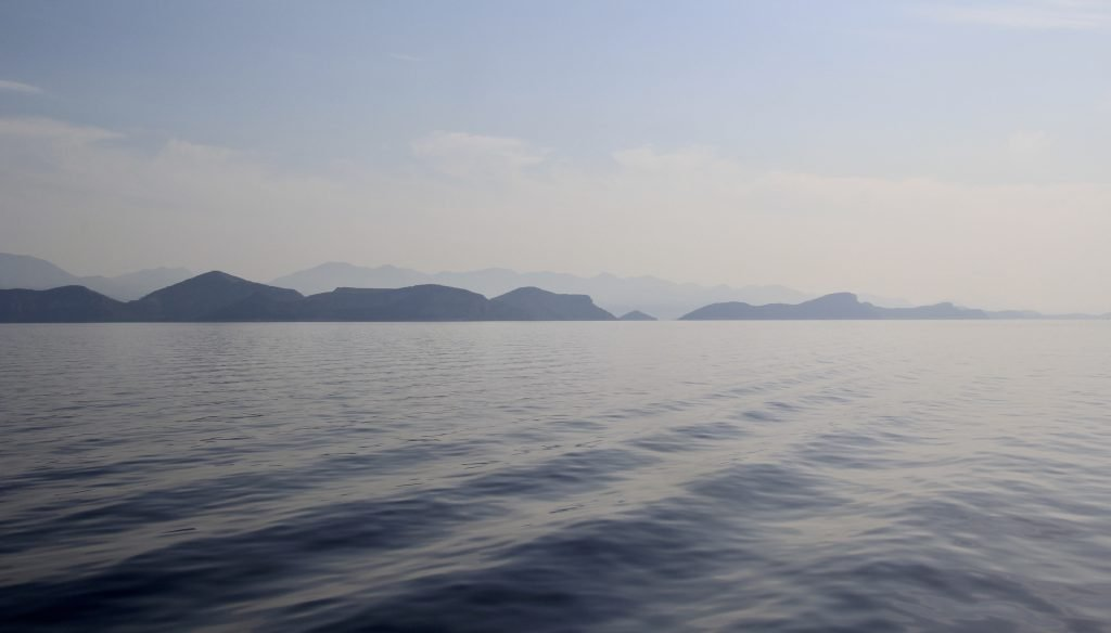 Smooth water and craggy coastline sailing on the Dalmatian Coast in Croatia in the morning