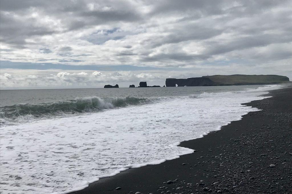Reynisfjara beach looking towards Dyrhólaey in south iceland