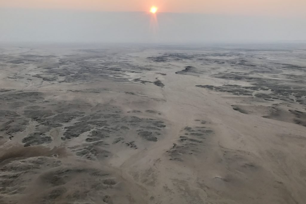 Sunrise over the rocky plains seen from a scenic flight over Namibia