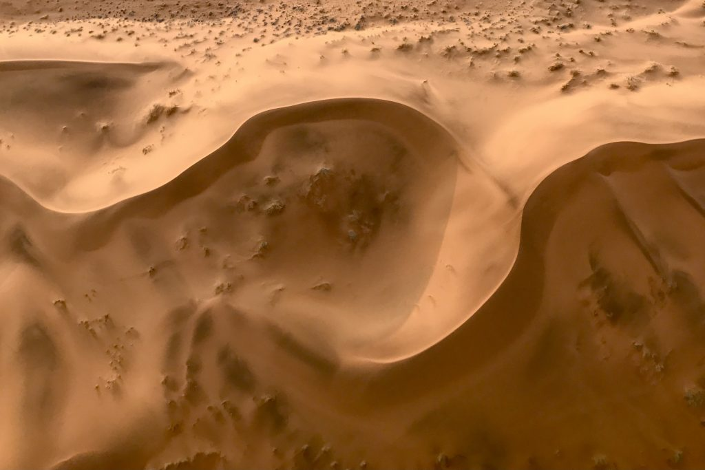 Circular dune formation with golden hues in the namib desert