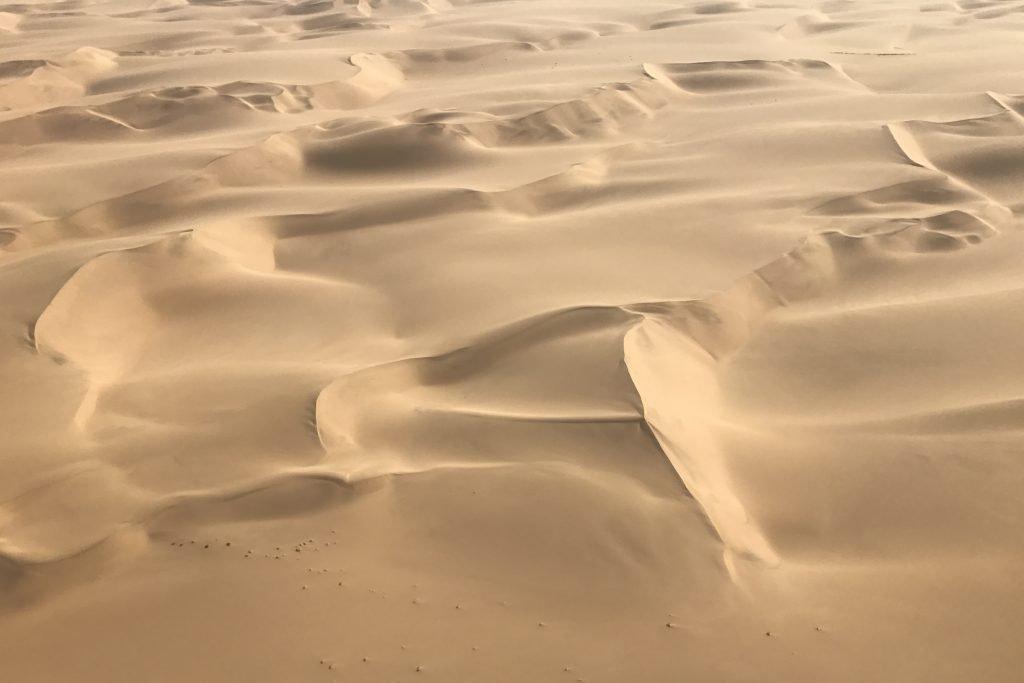 Dunes like folds of Cornish ice cream in the namib desert in namibia