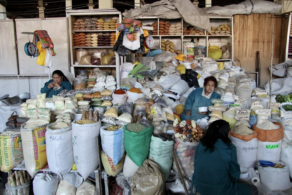 produce sellers in San Pedro Market in Cusco, Peru