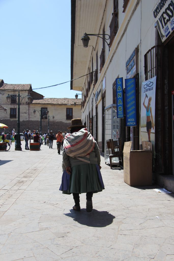 Lady in traditional dress in the streets of Cusco, Peru
