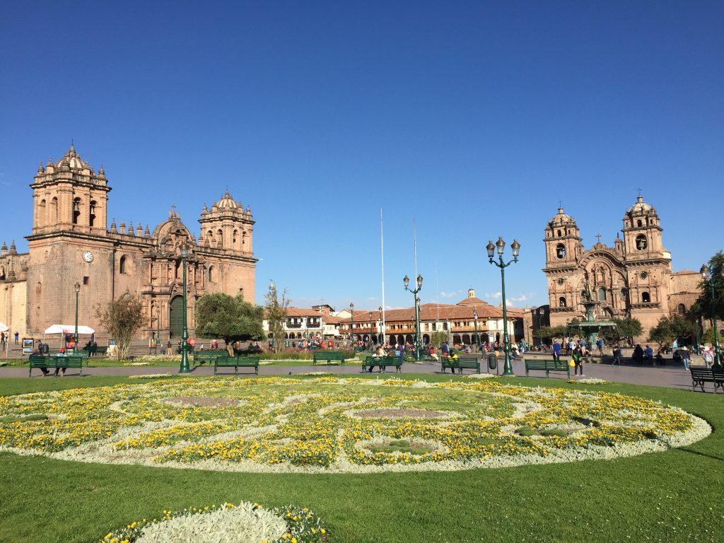 Two ornate cathedrals in Plaza de Armas in Cusco Peru