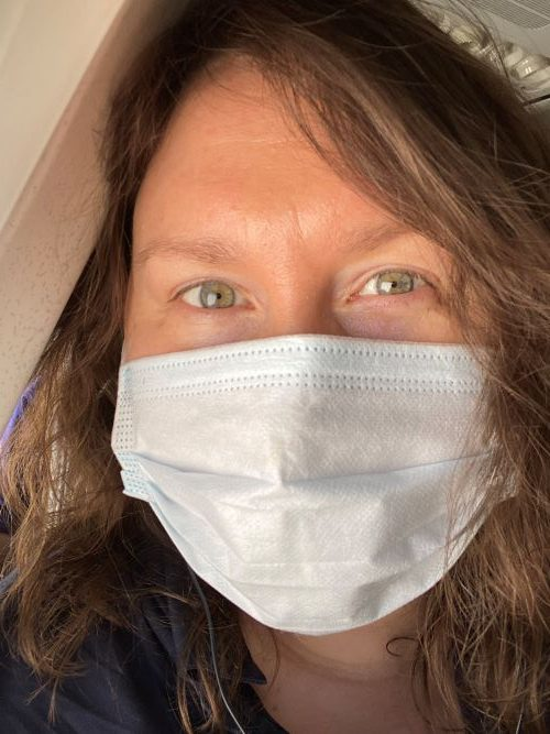 Author in a face mask, on a plane