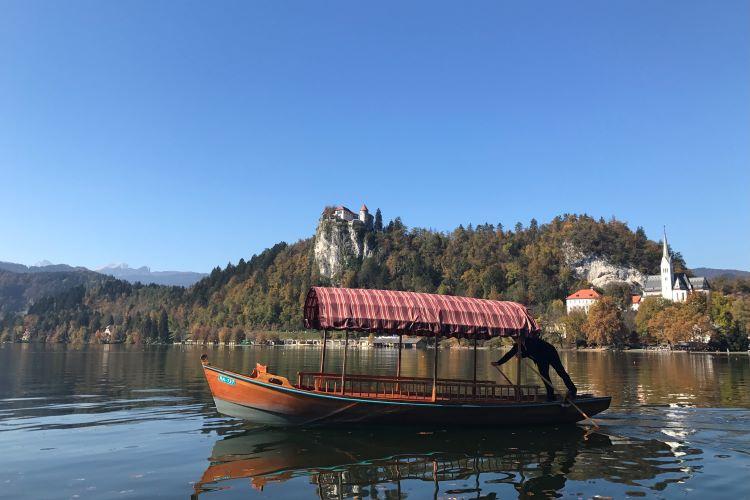 A covered wooden gondola, or pletna, on Lake Bled