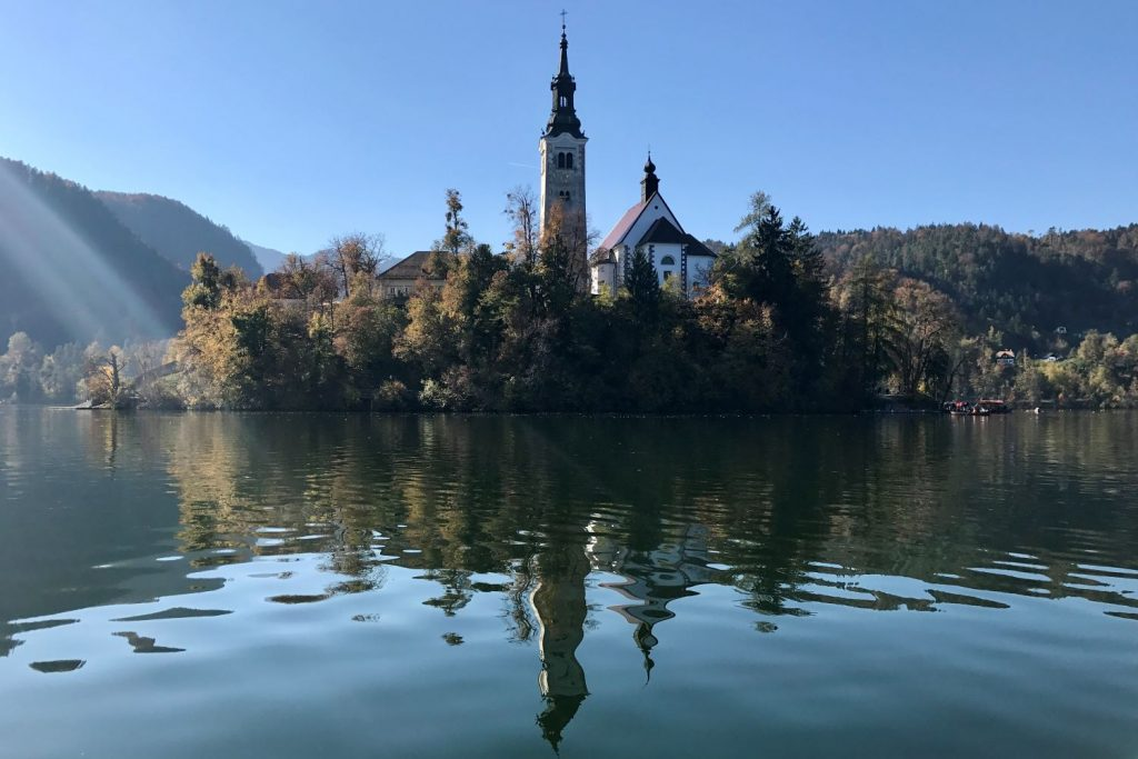 Lake Bled island reflecting in the water of Lake Bled