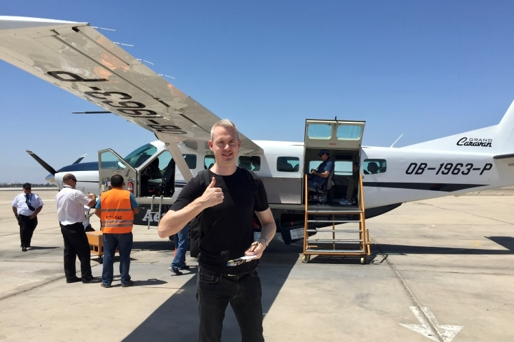 man giving a thumbs up in front of a Cessna plane before taking off on a Nazca Lines flight