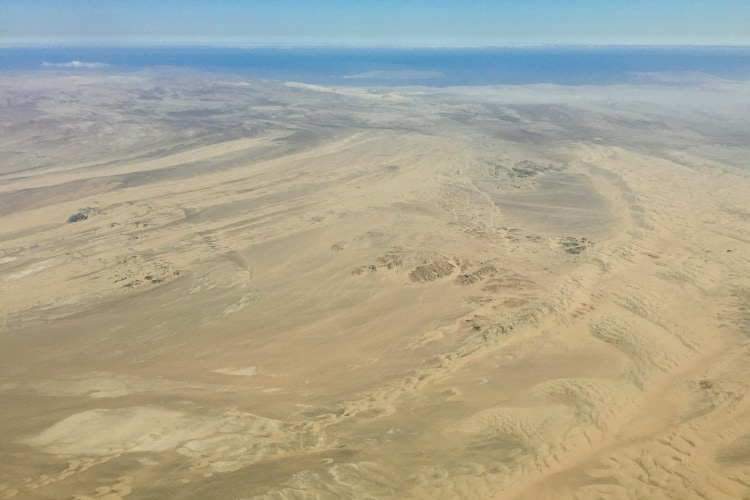 Desert views with sand dunes systems in the desert near Pisco taken from a Nazca Lines flight