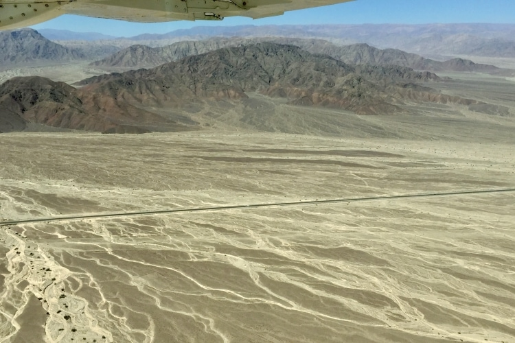 Mountains and dried river beds near the Nazca Lines seen from a Nazca lines flight