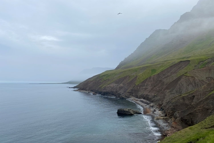 Steep headlands and calm seas on the northern tip of Trollaskagi in north iceland