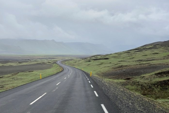 Iceland's ring road winding through green hills