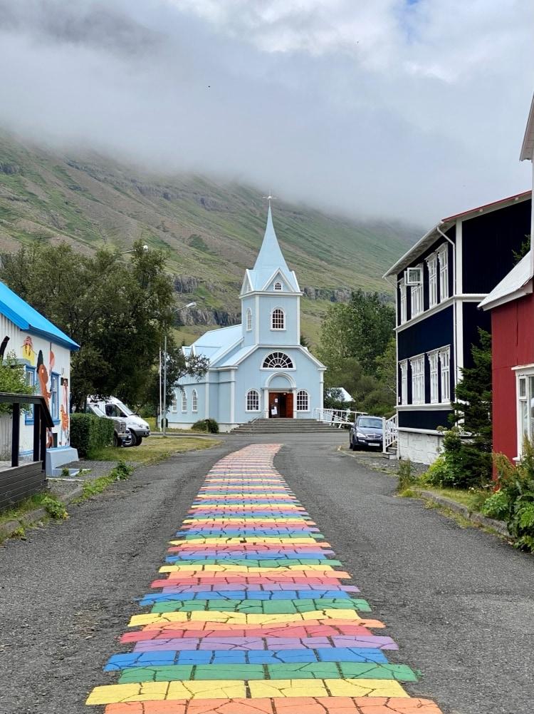 rainbow paving stones on the road to a church in Seyðisfjörður