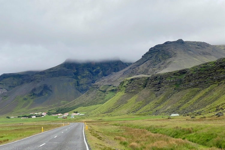 Moody black and green mountains near Hof on the ring road in South Iceland
