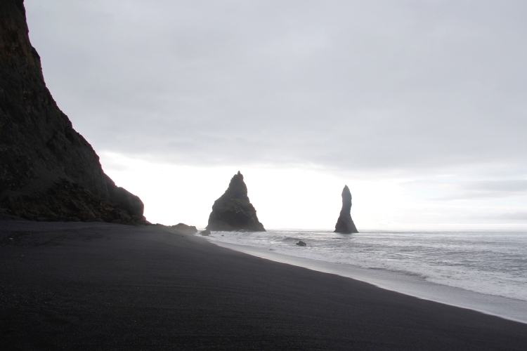 black sea stacks and black sand beach at Reynisfjara near the ring road in iceland