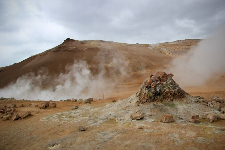 Mountain and steaming fumarole in Hverir geothermal area in north iceland