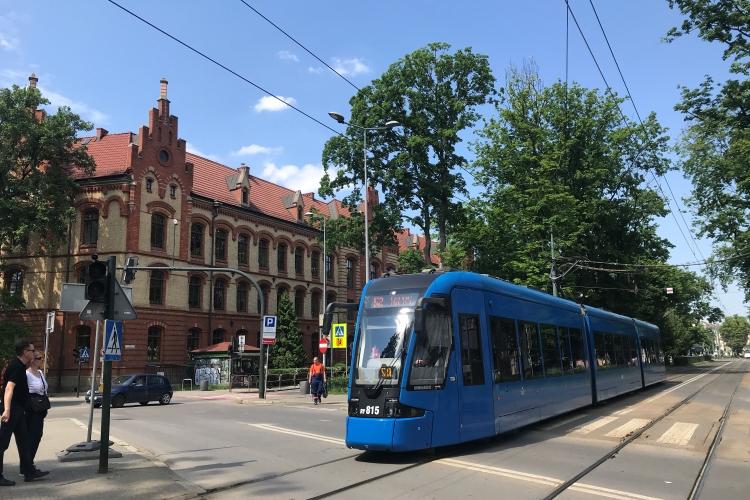 Blue Kraków tram in the street