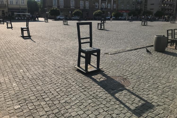 Bronze chairs in the Jewish Ghetto Memorial inPlac Bohaterów Getta