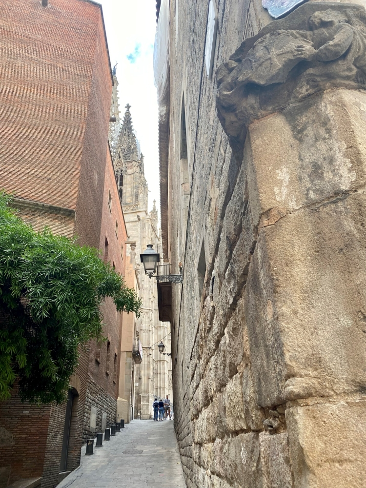alleyway with a glimpse of Barcelona Cathedral in the Gothic quarter